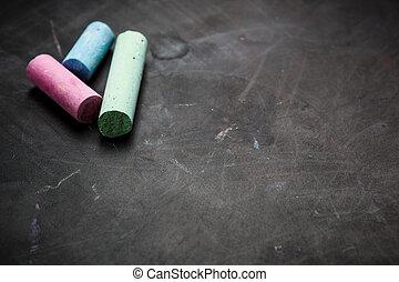 Black chalkboard texture.