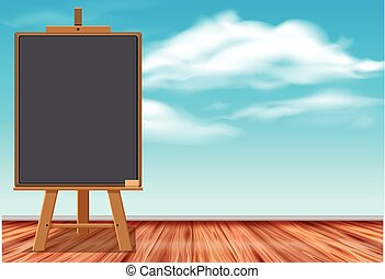 Black chalkboard with blue sky in background