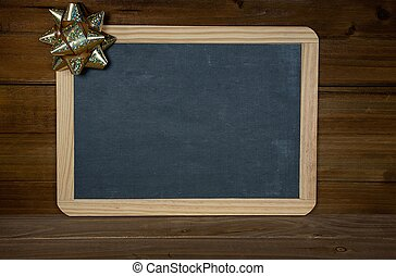 black chalkboard with gold bow