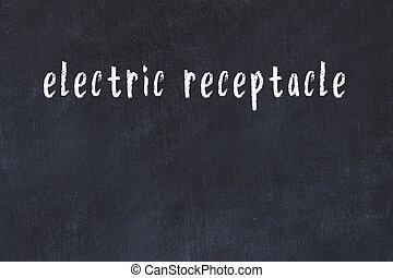 Chalk handwritten inscription electric receptacle on black desk