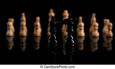 Black chess piece falling beside other pieces in slow motion
