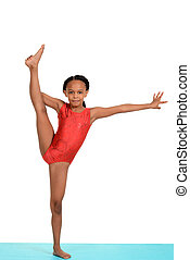 Black child doing gymnastics split on white background