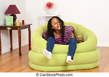 black child trying to get out chair