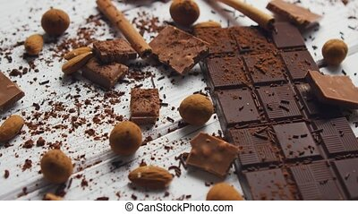 Black chocolate and spices - Closeup of arranged mess of...