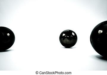 Black Christmas balls on white.