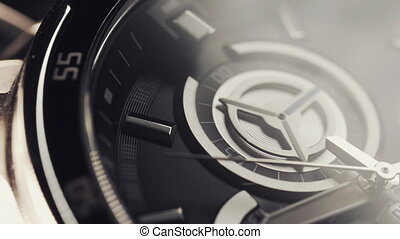 Black clocks running. The movement of the watch hands. ...