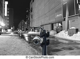 black close circuit television on night scene of footpath in alley at Hokkaido Japan
