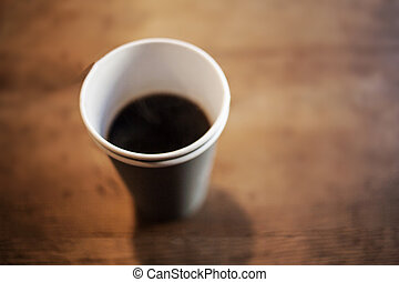 Black Coffee Americano in a paper cup on wooden table ...