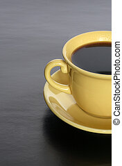 Black Coffee - Closeup of yellow cup with hot black coffee ...