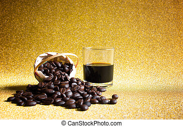 Black coffee cup and Coffee beans on golden background.