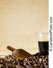 Black coffee cup and Coffee beans on wooden background.