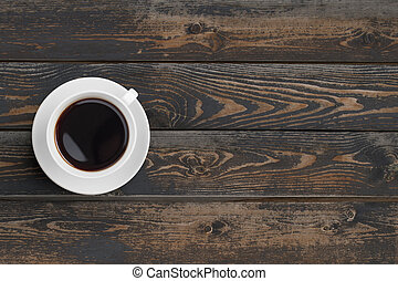 Black coffee cup on dark wooden table top view