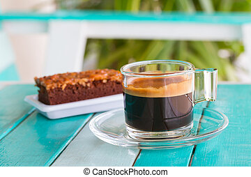 black coffee cup on white blue table