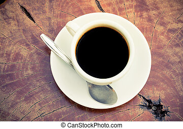 Black coffee cup on wood table top view