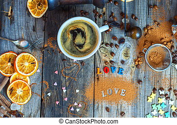 Black coffee in a cup on a gray wooden surface