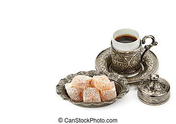 Black coffee in a stylish cup and Turkish delight isolated on a white background. Free space for text.