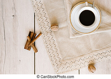 Black coffee in a white cup on napkin