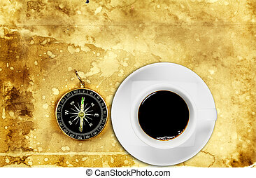 Black coffee in white cup with compass