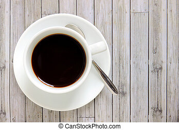 Black coffee in white cup with spoon