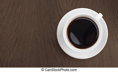 black coffee on wooden table top view