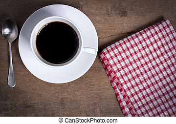 Black coffee served on a white cup and red pattern napkin ...