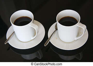 Black coffee - Two mugs of black coffee in white ceramic ...
