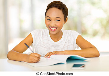 black college girl studying at home