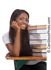 Black college student woman by stack of books
