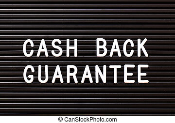 Black color felt letter board with white alphabet in word cash back guarantee background