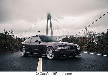 Black color luxury sport sedan on the road