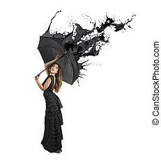 Concept of black color splash with girl holding umbrella