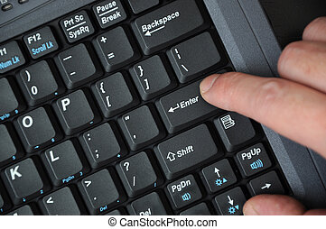 Black computer keyboard with hands