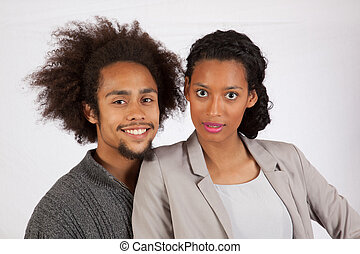 Affectionate black couple together romantically