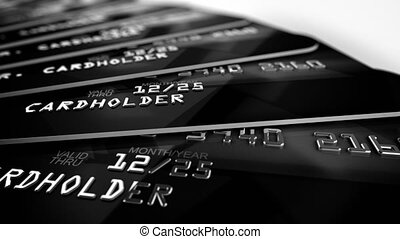 """Black Credit card close up shot with selective focus"""