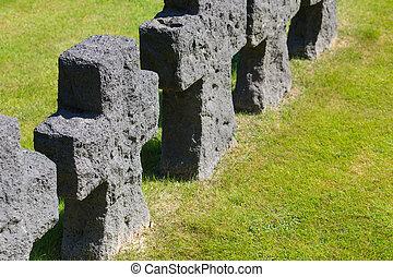 Black crosses on German world war 2 cemetery in La Cambe, Normandie, France