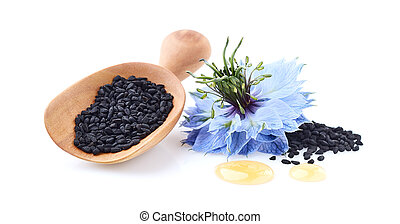 Black cumin seeds with flower on white background