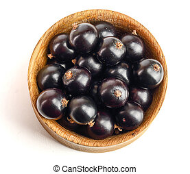 black currant in wooden bowl isolated on white background. Top view. Flat lay pattern