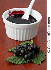Black currant jam in a white bowl