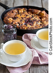 Black currant pie with tea