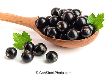 black currant with leaf in wooden spoon isolated on white background
