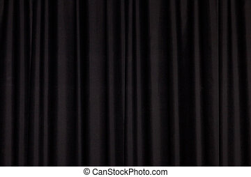Detail of a black closed curtain in a theatre