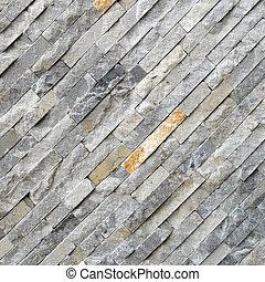 Black diagonal stone wall background