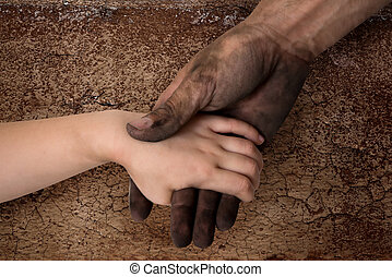 black dirty man hands holding kid clean hand