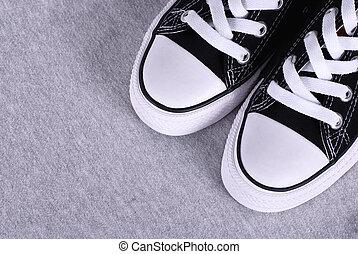 black , doek, gymschoen, op, grijze , textiel, achtergrond