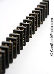 Black Dominoes Standing in Line