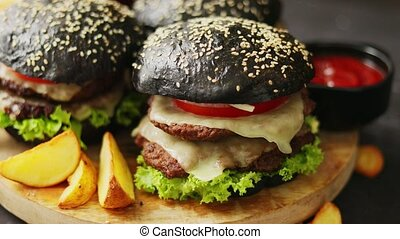 Black double Burgers with Cheese. Cheeseburgers from Japan ...