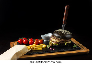 Black double hamburger made from beef with jalapeno pepper, cheese and vegetables-4