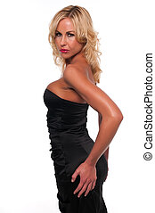Black dress - Pretty young blonde woman in a black sheath...