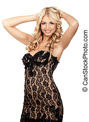 Black dress - Sexy blond lady in black dress isolated on...