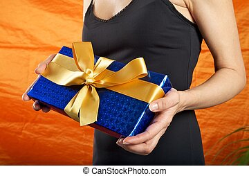 black dressed woman blue gift
